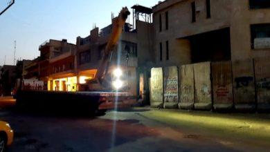 Photo of رفع الكتل الكونكريتية من محيط هيأة الضرائب وسط بغداد
