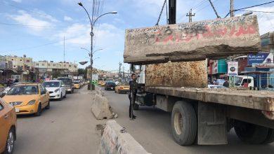 Photo of رفع الكتل الكونكريتية من محيط شارع الصحة جنوبي بغداد