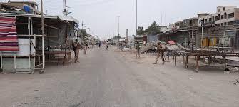 Photo of المباشرة بإجراءات العزل المناطقي في بغداد والبصرة