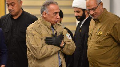 Photo of بالصور..اثناء زيارته هيئة الحـشـد الشعبي  الكاظمي يرتدي سترة الحـشد
