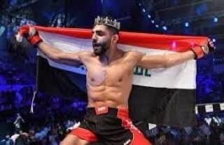 Photo of درجال يهنيء البطل العراقي العالمي بالفنون القتالية امير البازي